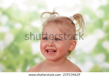 Cheerful blond Little girl with ponytails - stock photo