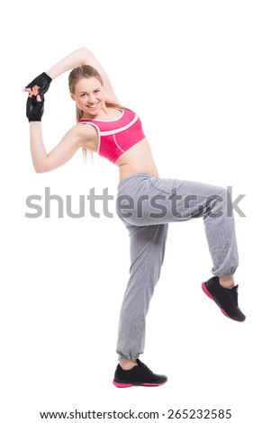 Cheerful blond woman wearing sport clothes. Isolated on white - stock photo