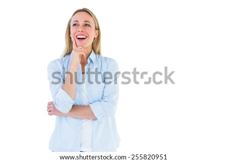 Cheerful blonde woman in casual clothes smiling on white background - stock photo