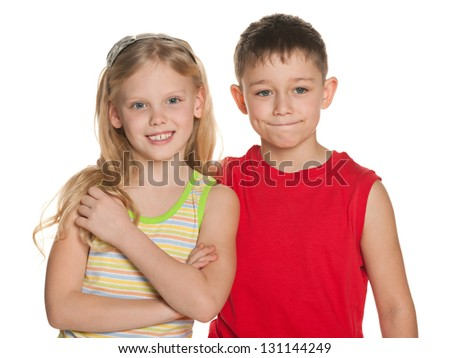 Cheerful  boy and  girl are standing together on the white background