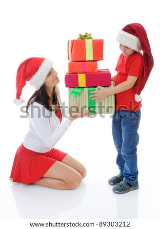 Cheerful boy and woman in Santa Claus hat. Isolated on white background - stock photo