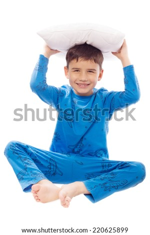 Cheerful boy holding a pillow over his head - stock photo