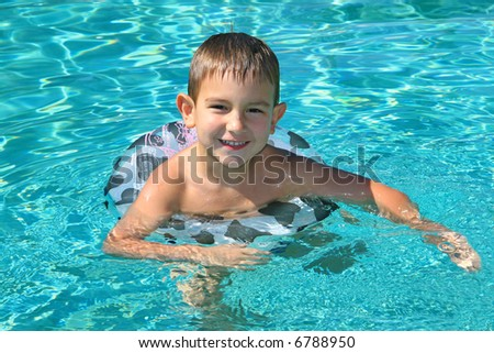 Cheerful boy in a swimming pool
