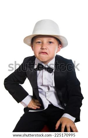 Cheerful boy in a tuxedo, isolation - stock photo