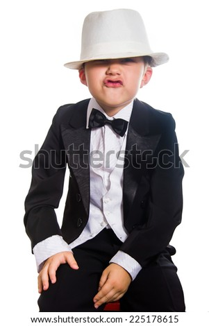 Cheerful boy in a tuxedo, isolation