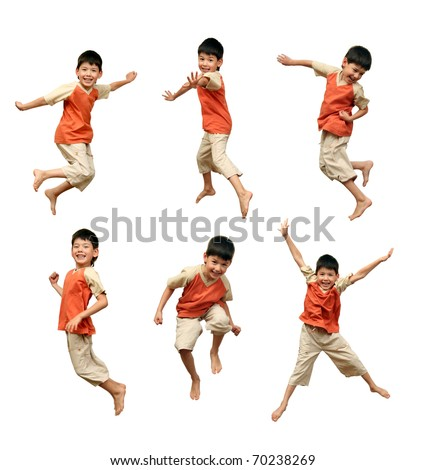 Cheerful boy in an orange shirt jumps up and waves his hands on a white background. - stock photo