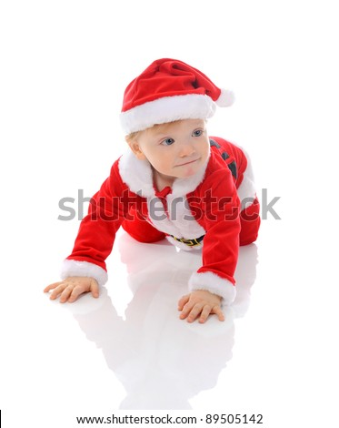 Cheerful boy in christmas hat. Isolated on white background