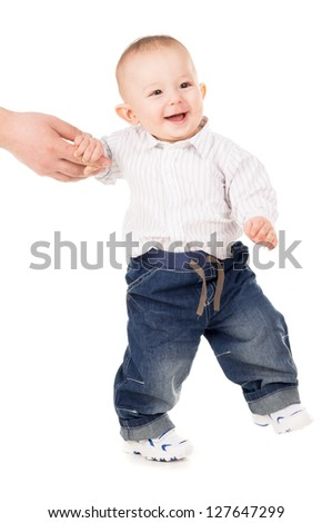 cheerful boy in clothes makes first steps isolated on white background - stock photo