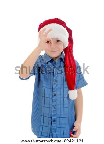 Cheerful boy in Santa Claus hat. Isolated on white background - stock photo