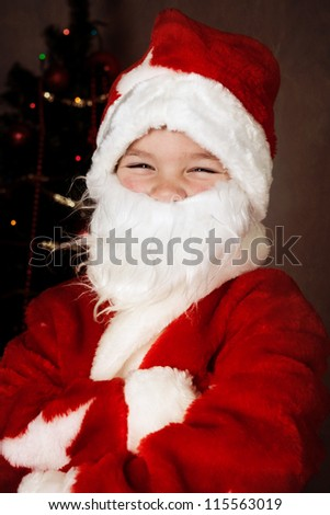 Cheerful boy in Santa Claus suit, new year - stock photo