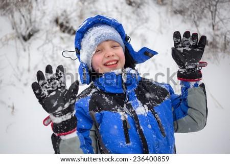 Cheerful boy sledding - stock photo