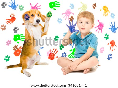 Cheerful boy with Beagle sitting  on the background of handprints - stock photo