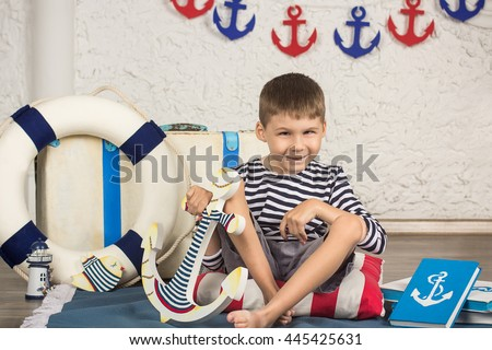 Cheerful  boy with cerebral palsy in a sailor suit - stock photo