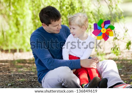 cheerful boy with his father enjoying summer time together - stock photo