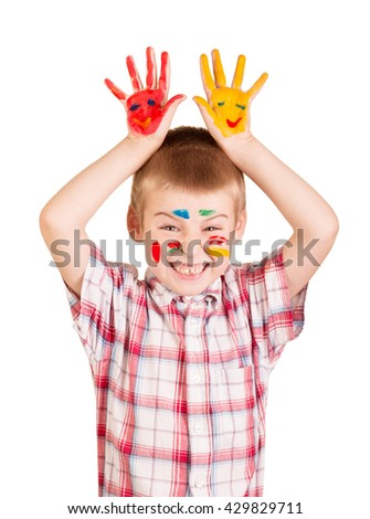 Cheerful boy with paint on his face and hands isolated on white background. - stock photo