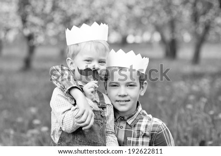 Cheerful boys with a paper crowns on their head - stock photo