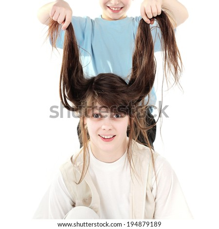 Cheerful Brother and Sister have Fun isolated on the white background - stock photo