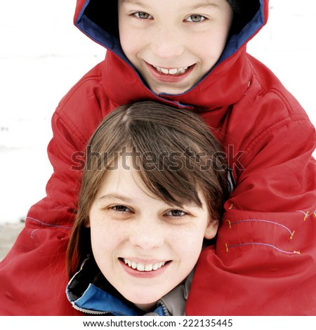 Cheerful Brother and Sister in the Winter on the white background - stock photo
