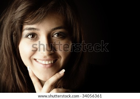 Cheerful brunette face portrait over dark background