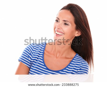 Cheerful brunette looking to her right in white background - copyspace - stock photo