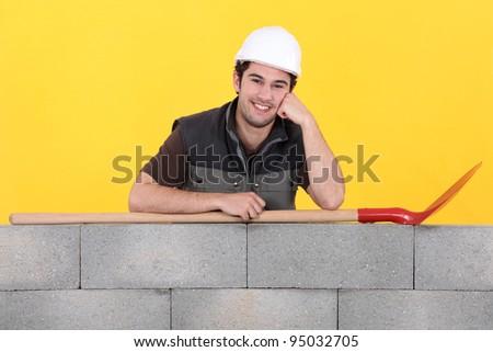 Cheerful builder - stock photo