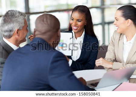 cheerful business group having monthly meeting - stock photo