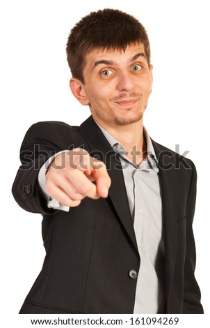 Cheerful business man pointing and make a choice isolated on white background