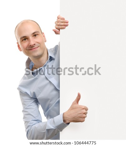 cheerful business man with blank banner showing thumbs up gesture - stock photo