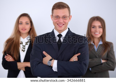 Cheerful business man  with colleagues in the background, start up team - stock photo