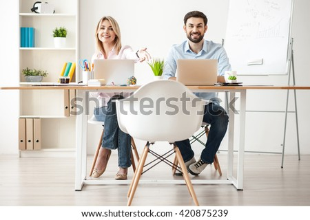 Cheerful business partners are inviting their client - stock photo