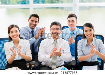 Cheerful business people applauding at the business conference - stock photo