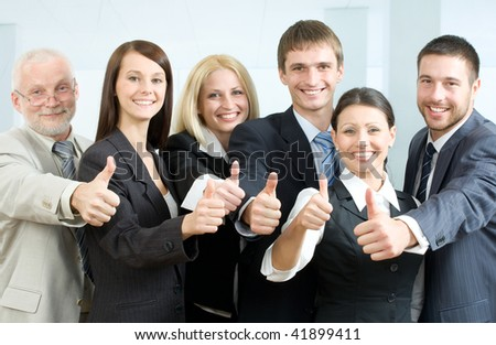 Cheerful business people showing that everything is OK