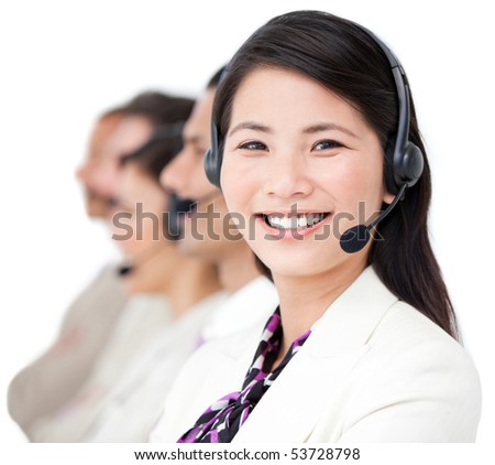 Cheerful business people with headset on standing against a white background - stock photo