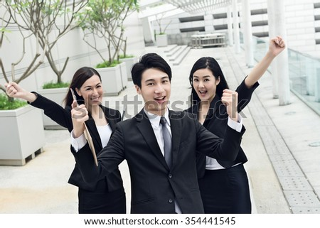 Cheerful business team at the outside of office, Hong Kong, China. - stock photo