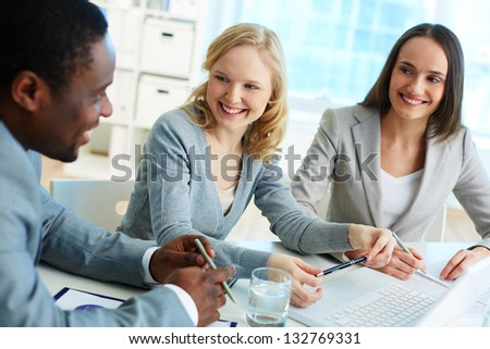 Cheerful business team gathering for a briefing - stock photo