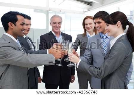 Cheerful business team toasting with Champagne to celebrate a success - stock photo