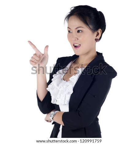 Cheerful business woman showing blank area for sign or copyspace, isolated over white background. Model is Asian woman - stock photo