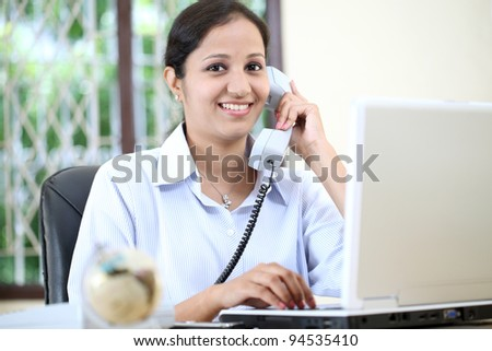 Cheerful business woman talking on phone