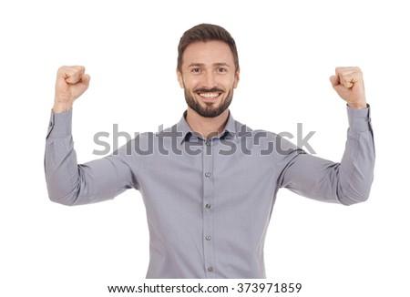 Cheerful businessman celebrating - stock photo