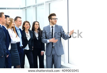 Cheerful businessman discussing a new business project with the members of his team - stock photo