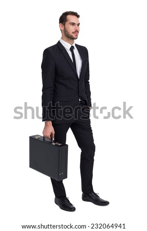 Cheerful businessman holding briefcase while hand in pocket on white background