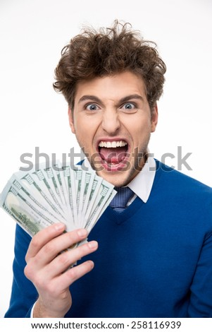Cheerful businessman holding money over gray background - stock photo