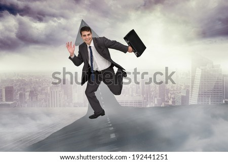 Cheerful businessman in a hurry against road turning into arrow