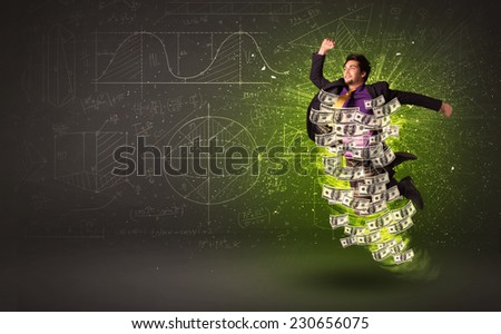 Cheerful businessman jumping with dollar banknotes around him on background - stock photo