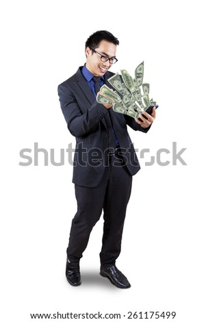 Cheerful businessman looking at dollar cash coming out from his cellphone, isolated on white - stock photo