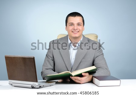 Cheerful businessman on gray background