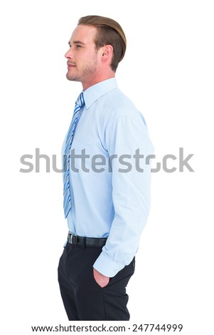 Cheerful businessman posing with hands in pockets on white background - stock photo