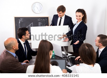 Cheerful businessman presents new development plan at poster in the office - stock photo