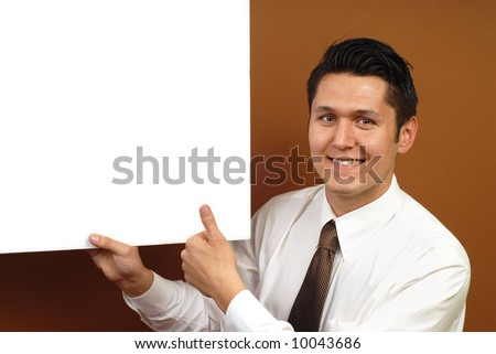 Cheerful businessman showing thumbs up with copy space - stock photo