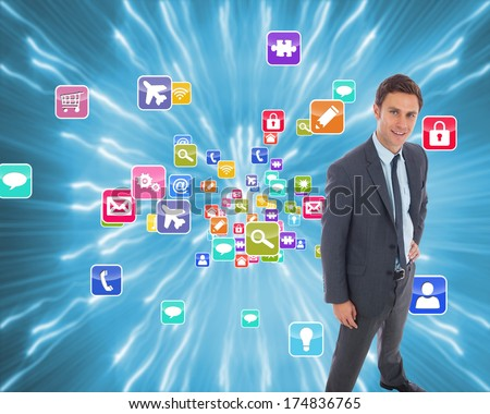 Cheerful businessman standing with hand on hip against strands of blue lights - stock photo